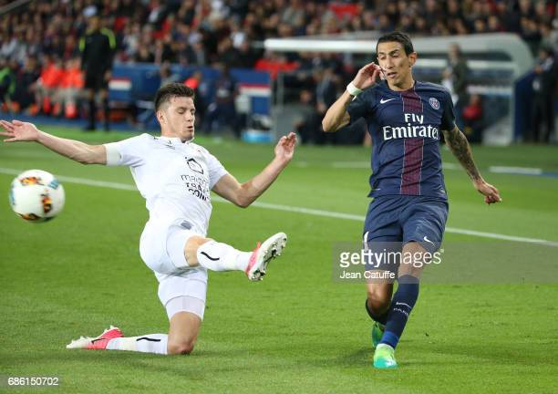 Frederic Guilbert of SM Caen Angel Di Maria of PSG during the French League 1 match between Paris SaintGermain and Stade Malherbe de Caen at Parc des...