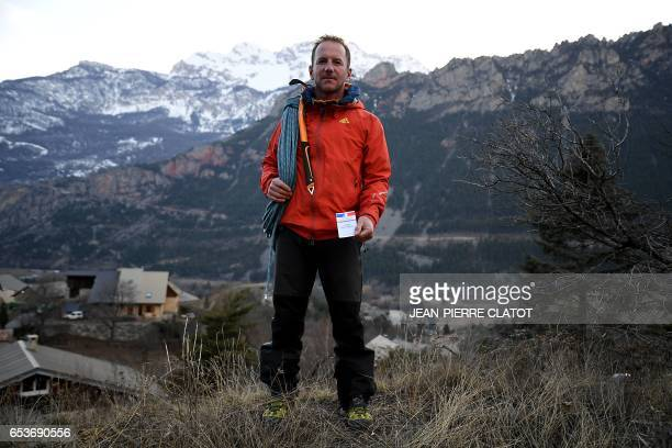 Frederic Jullien two children mountain guide living in the Alpes poses with his voting card in La RochedeRame southeastern France on February 23 2017...