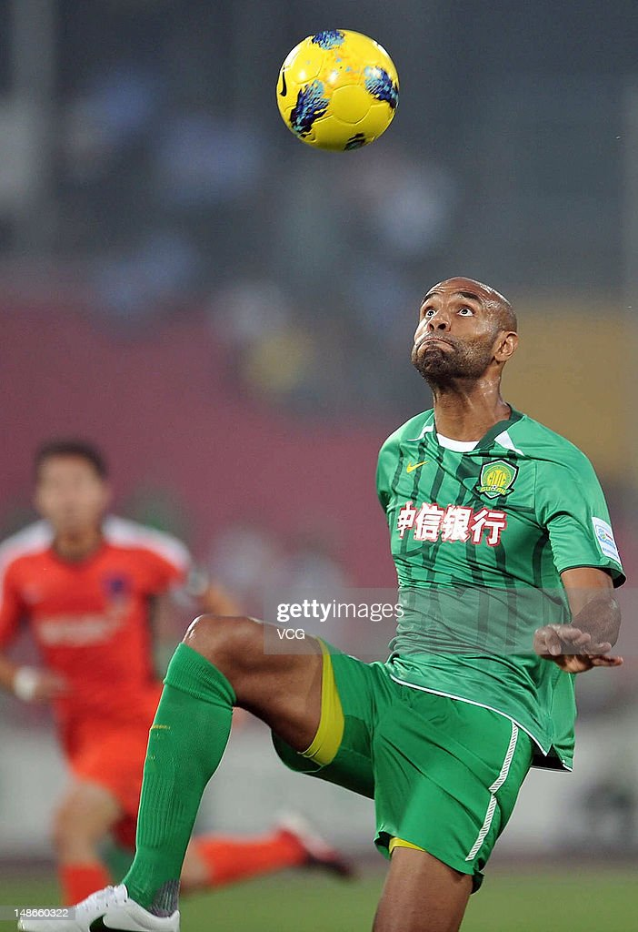 <a gi-track='captionPersonalityLinkClicked' href=/galleries/search?phrase=Frederic+Kanoute&family=editorial&specificpeople=213590 ng-click='$event.stopPropagation()'>Frederic Kanoute</a> of Beijing Guo'an eyes the ball during the Chinese FA Cup match between Beijing Guo'an and Qingdao Jonoon at Workers Stadium on July 18, 2012 in Beijing, China.