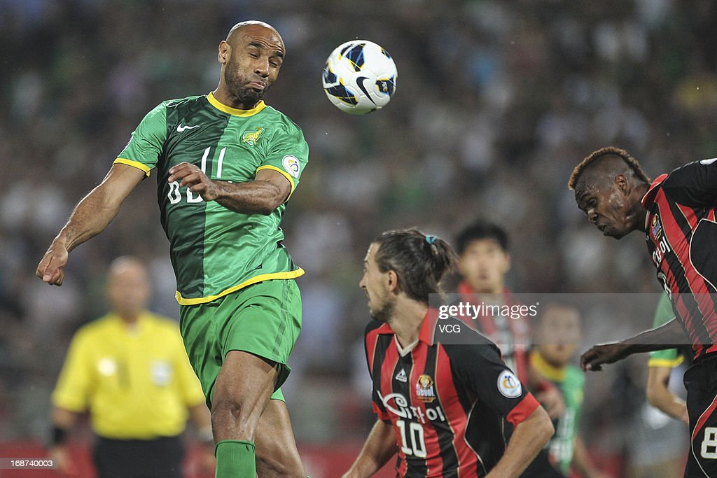 <a gi-track='captionPersonalityLinkClicked' href=/galleries/search?phrase=Frederic+Kanoute&family=editorial&specificpeople=213590 ng-click='$event.stopPropagation()'>Frederic Kanoute</a> #11 of Beijing Guoan jumps to head the ball during the AFC Champions League Round of 16 match between Beijing Guoan and FC Seoul at Workers Stadium on May 14, 2013 in Beijing, China.
