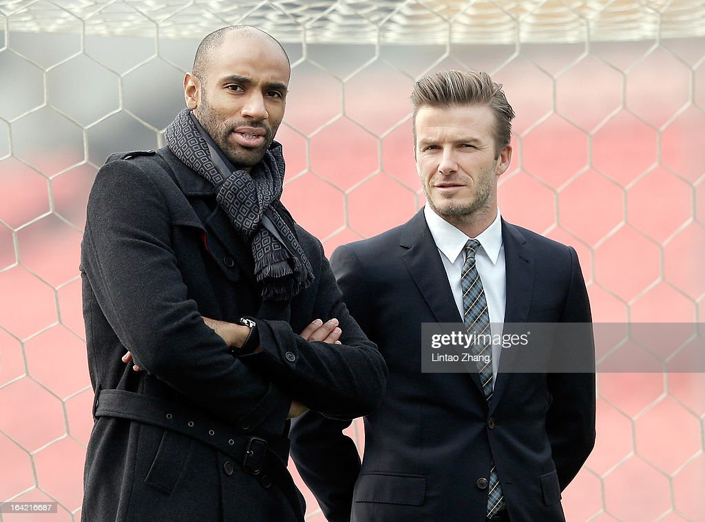 <a gi-track='captionPersonalityLinkClicked' href=/galleries/search?phrase=Frederic+Kanoute&family=editorial&specificpeople=213590 ng-click='$event.stopPropagation()'>Frederic Kanoute</a> (L) of Beijing Guo'an stands with with British football player <a gi-track='captionPersonalityLinkClicked' href=/galleries/search?phrase=David+Beckham&family=editorial&specificpeople=158480 ng-click='$event.stopPropagation()'>David Beckham</a> during his visit to Beijing Guo'an Football Club at Workers Stadium on March 21, 2013 in Beijing, China. <a gi-track='captionPersonalityLinkClicked' href=/galleries/search?phrase=David+Beckham&family=editorial&specificpeople=158480 ng-click='$event.stopPropagation()'>David Beckham</a> is on a five-day visit to China at the invitation of the China Football Association as China's first international ambassador.