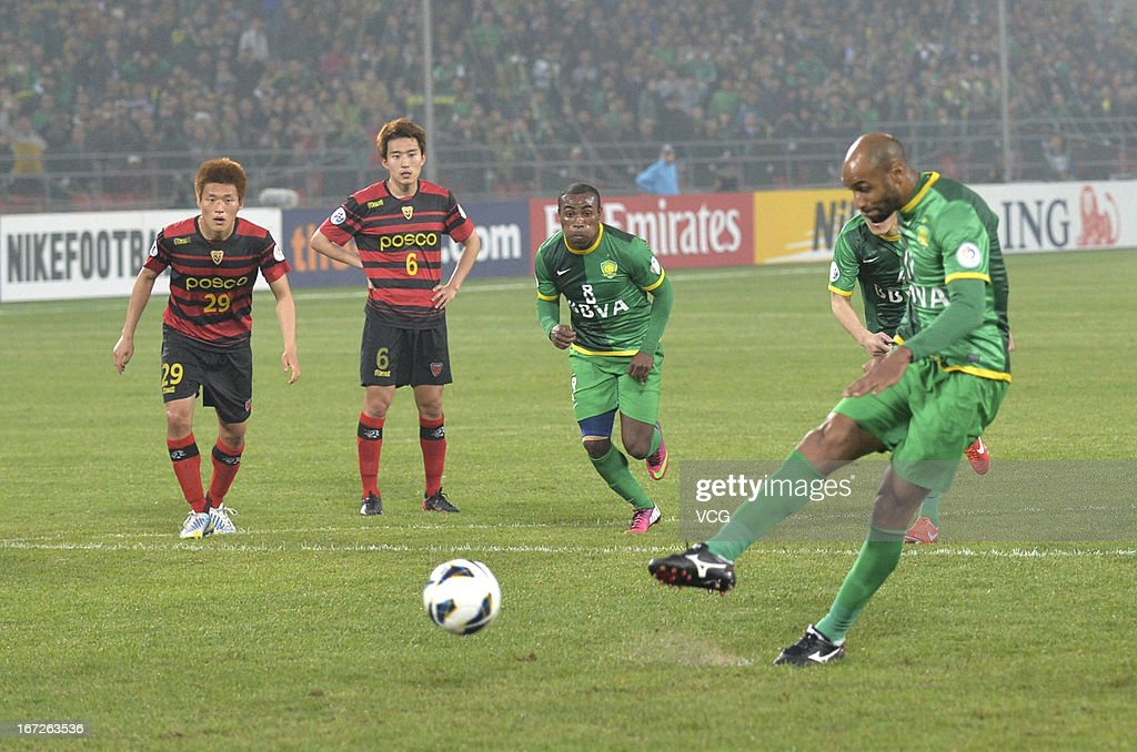 <a gi-track='captionPersonalityLinkClicked' href=/galleries/search?phrase=Frederic+Kanoute&family=editorial&specificpeople=213590 ng-click='$event.stopPropagation()'>Frederic Kanoute</a> #11 of Beijing Guoan takes a penalty kick during the AFC Champions League Group match between Beijing Guoan and Pohang Steelers at Beijing Workers' Stadium on April 23, 2013 in Beijing, China.