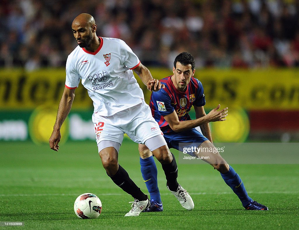 <a gi-track='captionPersonalityLinkClicked' href=/galleries/search?phrase=Frederic+Kanoute&family=editorial&specificpeople=213590 ng-click='$event.stopPropagation()'>Frederic Kanoute</a> (R) of Sevilla FC duels for the ball with <a gi-track='captionPersonalityLinkClicked' href=/galleries/search?phrase=Sergio+Busquets&family=editorial&specificpeople=5477015 ng-click='$event.stopPropagation()'>Sergio Busquets</a> of FC Barcelona during the la Liga match between Sevilla and FC Barcelona at the Estadio Ramon Sanchez Pizjuan on March 17, 2012 in Seville, Spain.