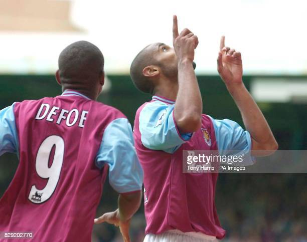 Frederic Kanoute points with two fingers as he celebrates after scoring West Ham United's 2nd goal at Upton Park during their FA Barclaycard...