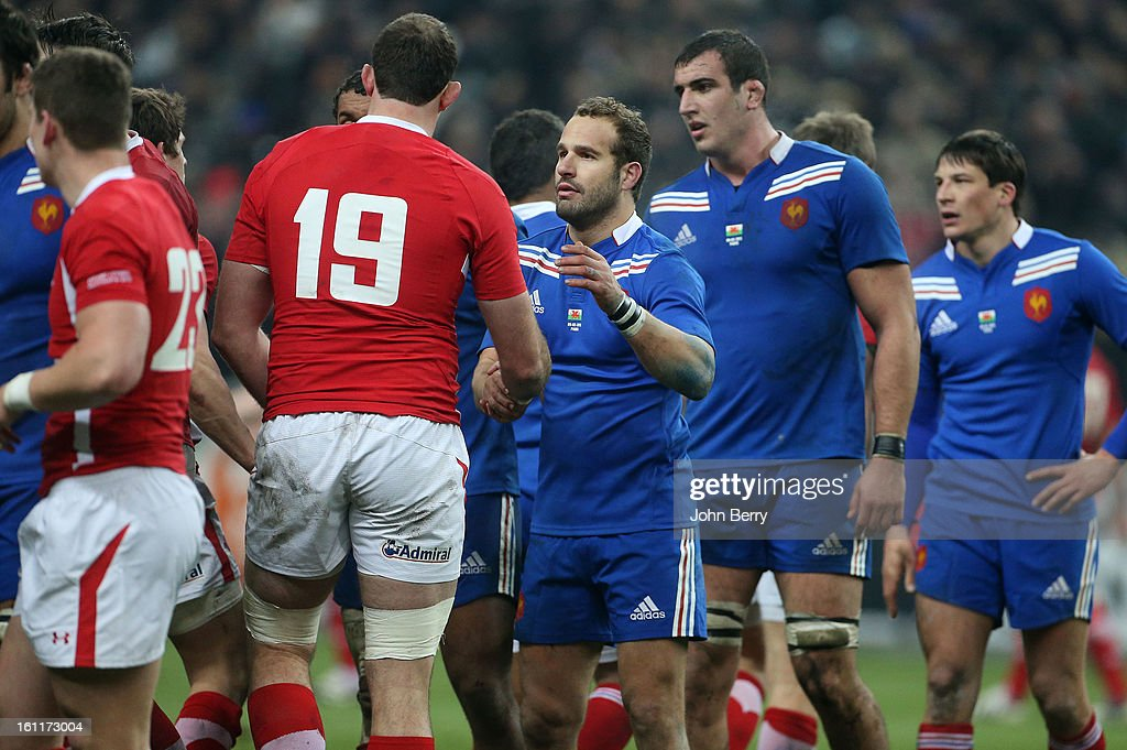 Frederic Michalak and Louis Picamoles of France congratulate Wales players at the end of the 6 Nations match between France and Wales at the Stade de France on February 9,, 2013 in Paris, France.