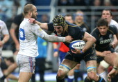 Frederic Michalak of France and Kelly Brown of Scotland in action during the RBS Six Nations match between France and Scotland at the Stade de France...