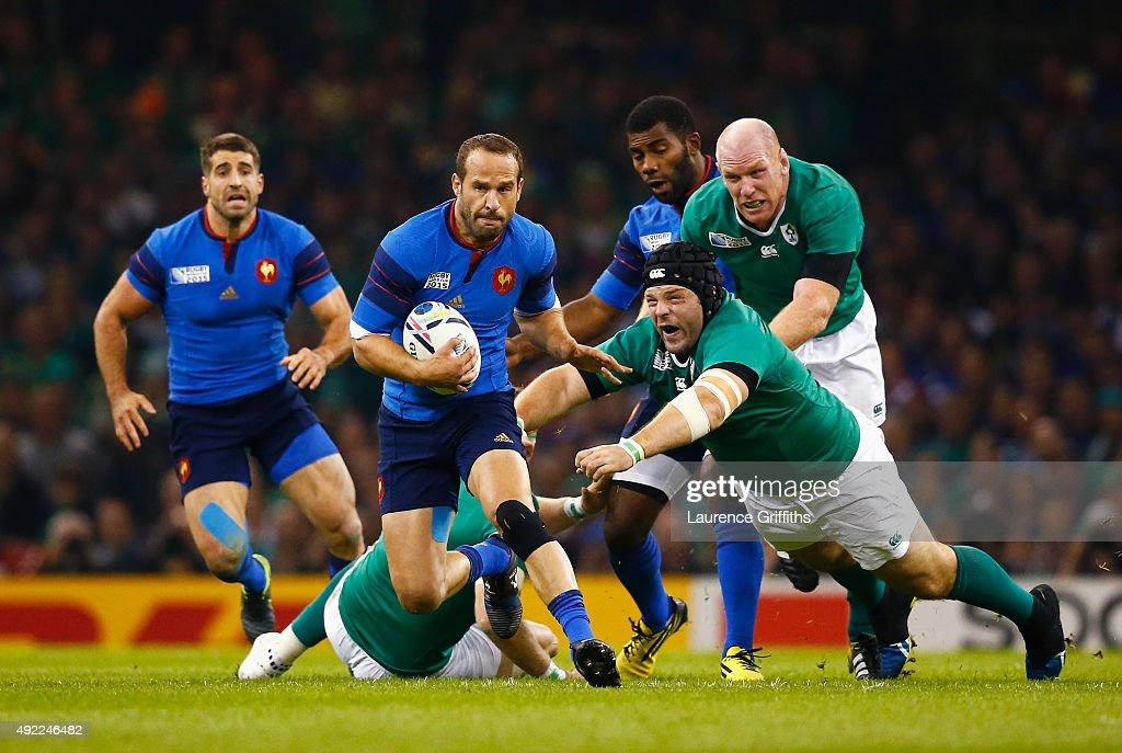 Frederic Michalak of France evades a challenge from Mike Ross of Ireland during the 2015 Rugby World Cup Pool D match between France and Ireland at Millennium Stadium on October 11, 2015 in Cardiff, United Kingdom.