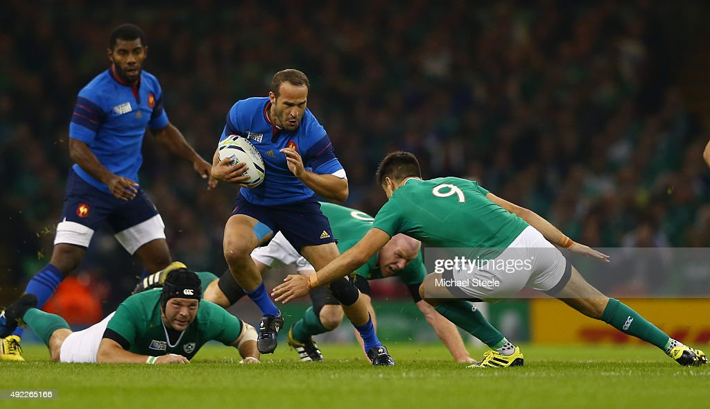 Frederic Michalak of France is tackled by <a gi-track='captionPersonalityLinkClicked' href=/galleries/search?phrase=Conor+Murray+-+Jugador+de+rugby&family=editorial&specificpeople=6820654 ng-click='$event.stopPropagation()'>Conor Murray</a> of Ireland during the 2015 Rugby World Cup Pool D match between France and Ireland at Millennium Stadium on October 11, 2015 in Cardiff, United Kingdom.