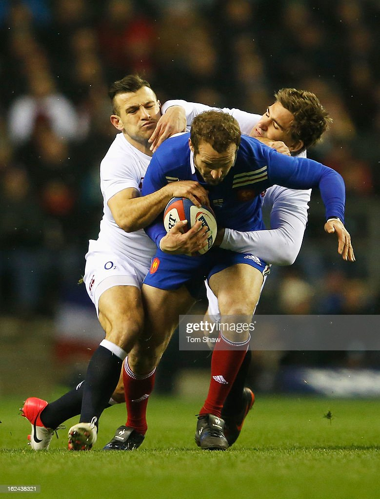Frederic Michalak of France is tackled by <a gi-track='captionPersonalityLinkClicked' href=/galleries/search?phrase=Danny+Care&family=editorial&specificpeople=539686 ng-click='$event.stopPropagation()'>Danny Care</a> and <a gi-track='captionPersonalityLinkClicked' href=/galleries/search?phrase=Toby+Flood&family=editorial&specificpeople=551191 ng-click='$event.stopPropagation()'>Toby Flood</a> of England during the RBS Six Nations match between England and France at Twickenham Stadium on February 23, 2013 in London, England.