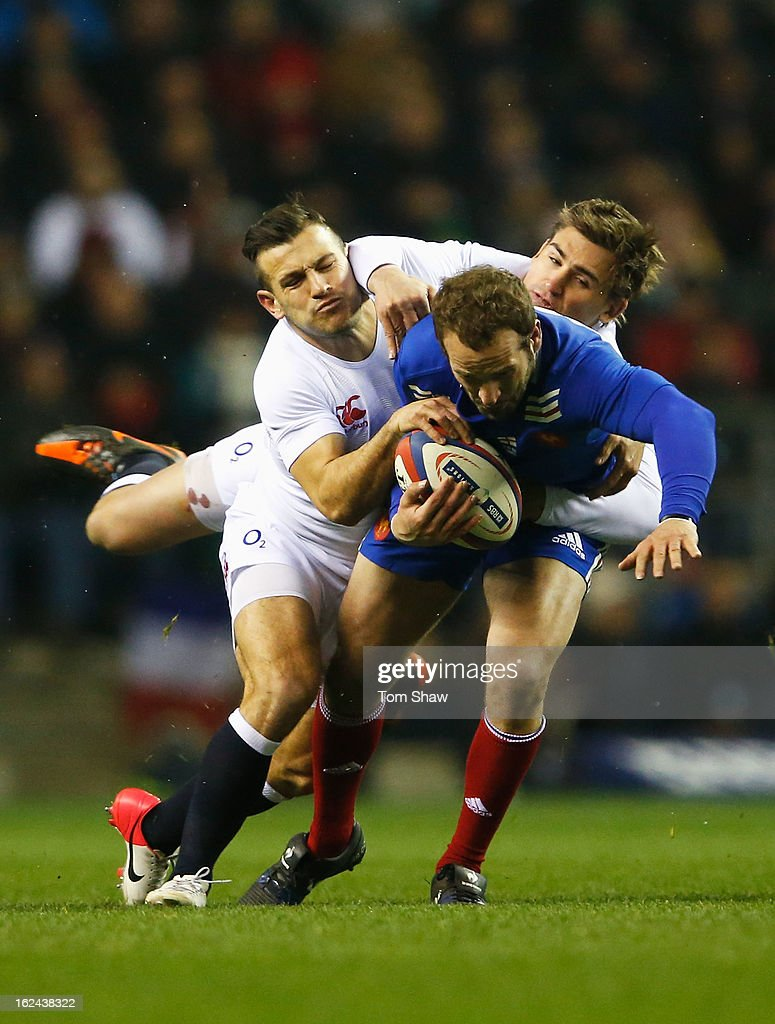 Frederic Michalak of France is tackled by Danny Care and Toby Flood of England during the RBS Six Nations match between England and France at Twickenham Stadium on February 23, 2013 in London, England.