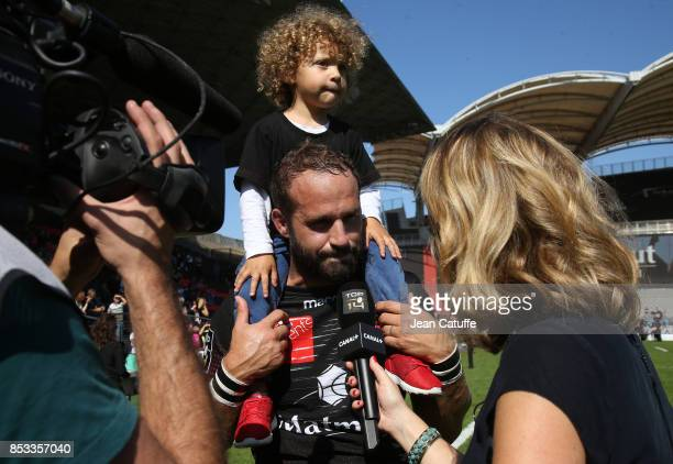 Frederic Michalak of LOU is interviewed by Astrid Bard of Canal Plus following the Top 14 match between Lyon OU and Castres Olympique at Matmut...