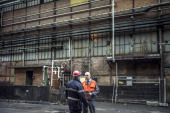 Frederic Midy general director of Aperam stainless steel factory controlled by the Mittal family speaks with a firefighter on December 24 2012 in...