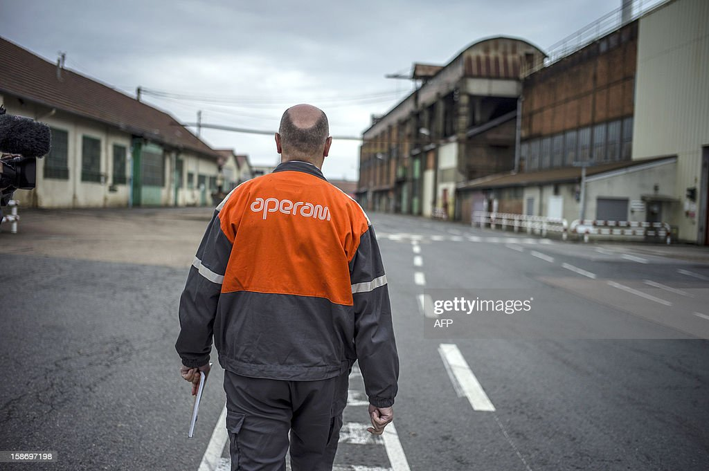 Frederic Midy, general director of Aperam stainless steel factory, controlled by the Mittal family, on December 24, 2012 in Gueugnon, central France, walks on the site where a fire broke out overnight, burning 4000 square meters with no casualties.