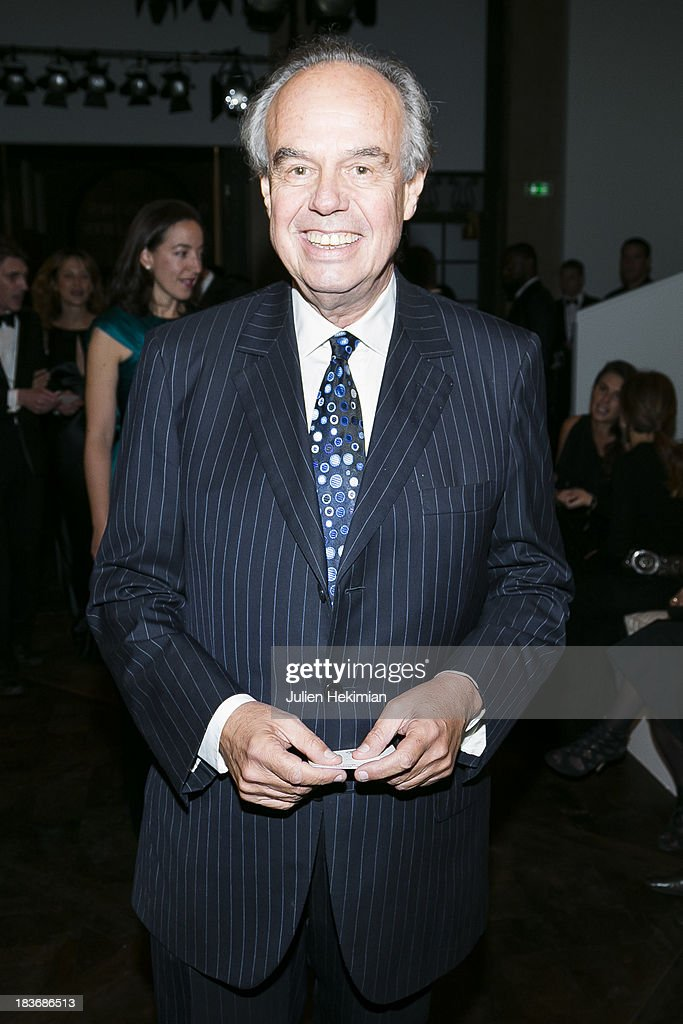 <a gi-track='captionPersonalityLinkClicked' href=/galleries/search?phrase=Frederic+Mitterrand&family=editorial&specificpeople=621709 ng-click='$event.stopPropagation()'>Frederic Mitterrand</a> poses after arriving at Les Beaux-Arts de Paris on October 8, 2013 in Paris, France. On this occasion Ralph Lauren celebrates the restoration project and patron sponsorship of L'Ecole des Beaux-Arts.