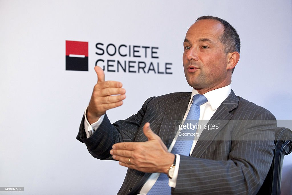 <a gi-track='captionPersonalityLinkClicked' href=/galleries/search?phrase=Frederic+Oudea&family=editorial&specificpeople=962128 ng-click='$event.stopPropagation()'>Frederic Oudea</a>, chief executive officer of Societe Generale SA, gestures as he speaks during a Bloomberg Television interview at the company's headquarters in Paris, France, on Tuesday, July 31, 2012. Societe Generale SA, France's second-largest bank, posted a bigger-than-expected 42 percent drop in second-quarter profit after taking write downs on its Russian unit and U.S. asset manager TCW Group. Photographer: Balint Porneczi/Bloomberg via Getty Images