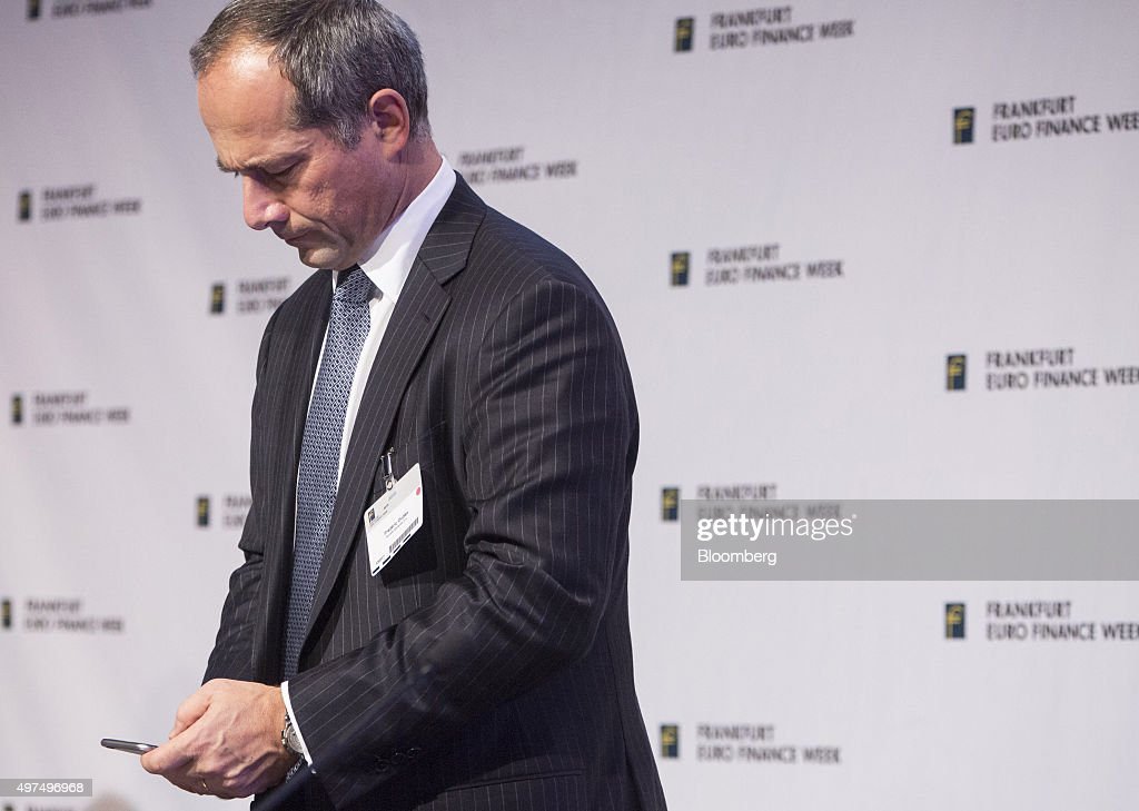 Frederic Oudea chief executive officer of Societe Generale SA checks his mobile phone during Euro Finance Week in Frankfurt Germany on Tuesday Nov 17...