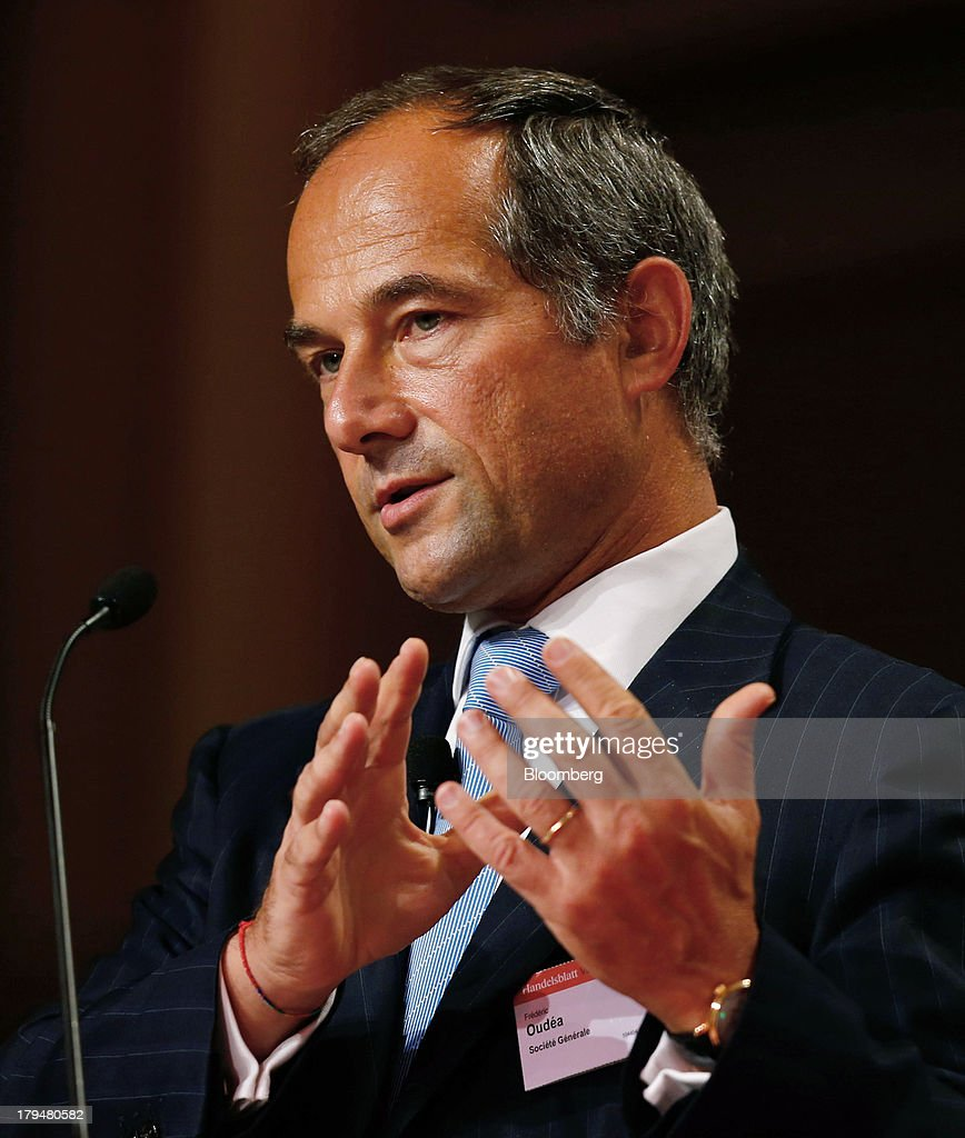 Frederic Oudea chief executive officer of Societe Generale SA gestures while speaking during the 'Banks in Transition' banking conference in...