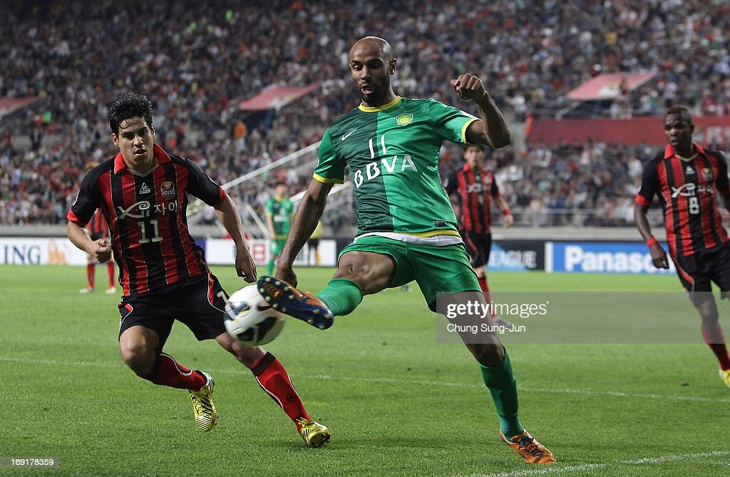 Frederic Oumar Kanoute of Beijing Go'an wins the ball ahead of Molina Uribe (L) of FC Seoul during the AFC Champions League round of 16 match between FC Seoul and Beijing Go'an at Seoul World Cup Stadium on May 21, 2013 in Seoul, South Korea.