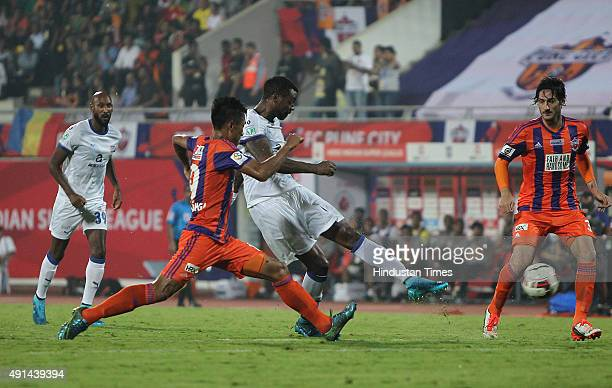 Frederic Piquionne of Mumbai City FC takes a shot against FC Pune City during the Indian Super League match at Shree Shiv Chhatrapati Sports Complex...