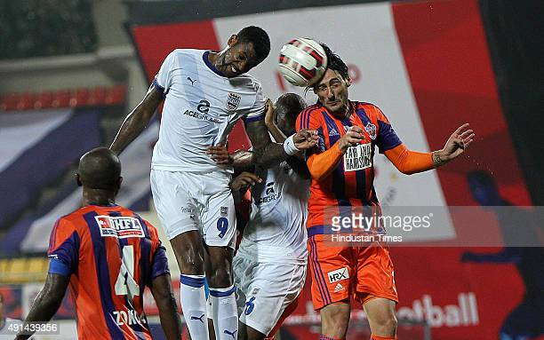 Frederic Piquionne of Mumbai City FC trying header aimed at goal post on a corner kick against FC Pune City during the Indian Super League match at...