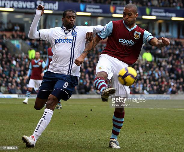 Frederic Piquionne of Portsmouth battles with Clarke Carlisle of Burnley during the Barclays Premier League match between Burnley and Portsmouth at...