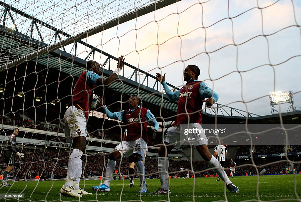 <a gi-track='captionPersonalityLinkClicked' href=/galleries/search?phrase=Frederic+Piquionne&family=editorial&specificpeople=660926 ng-click='$event.stopPropagation()'>Frederic Piquionne</a> of West Ham congratulates team mate <a gi-track='captionPersonalityLinkClicked' href=/galleries/search?phrase=Carlton+Cole&family=editorial&specificpeople=215313 ng-click='$event.stopPropagation()'>Carlton Cole</a> on scoring the opening goal during the Barclays Premier League match between West Ham United and Newcastle United at The Boleyn Ground on October 23, 2010 in London, England.
