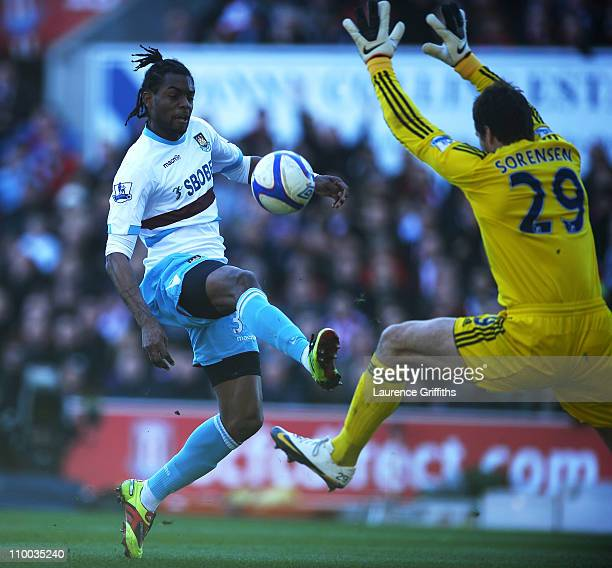 Frederic Piquionne of West Ham United scores his goal past goalkeeper Thomas Sorensen of Stoke City during the FA Cup sponsored by EON 6th Round...