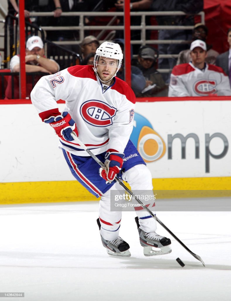 Frederic St Denis of the Montreal Canadiens skates with the puck during an NHL game against the Carolina Hurricanes on April 5 2012 at PNC Arena in...