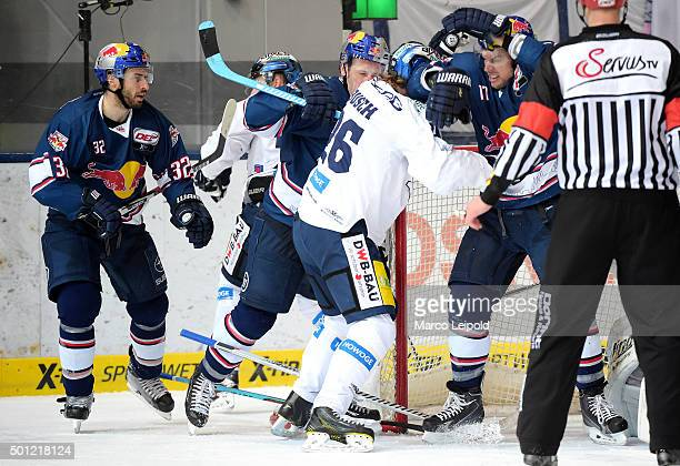 Frederic StDenis Jason Jaffray Florian Busch of the Eisbaeren Berlin and Jerome Samson of EHC Red Bull Muenchen during the game between EHC Red Bull...