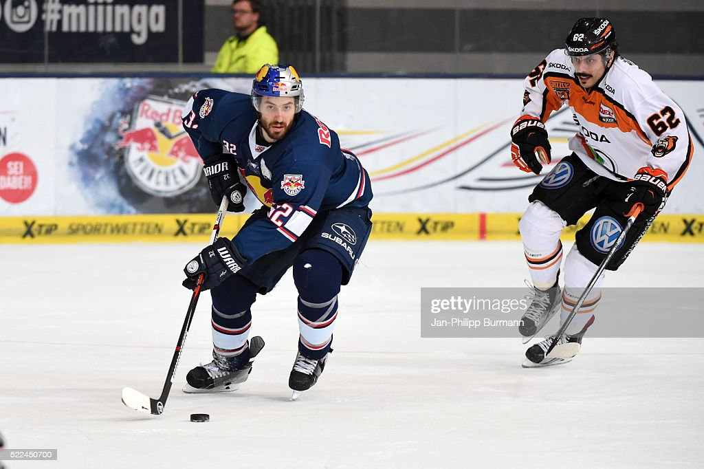 Frederic StDenis of EHC Red Bull Muenchen and Daniel Widing of Grizzlys Wolfsburg during the DEL playoff match between the EHC Red Bull Muenchen and...