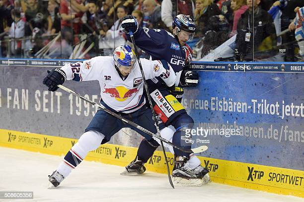 Frederic StDenis of EHC Red Bull Muenchen and Marcel Noebels of the Eisbaeren Berlin during the game between the Eisbaeren Berlin and EHC Red Bull...