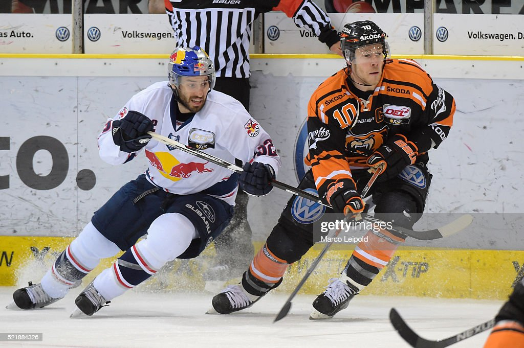 Frederic StDenis of EHC Red Bull Muenchen and Tyler Haskins of the Grizzlys Wolfsburg during the game between the Grizzlys Wolfsburg and dem EHC Red...