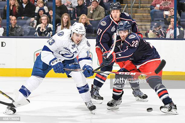Frederic StDenis of the Columbus Blue Jackets defends against Cedric Paquette of the Tampa Bay Lightning on November 8 2014 at Nationwide Arena in...