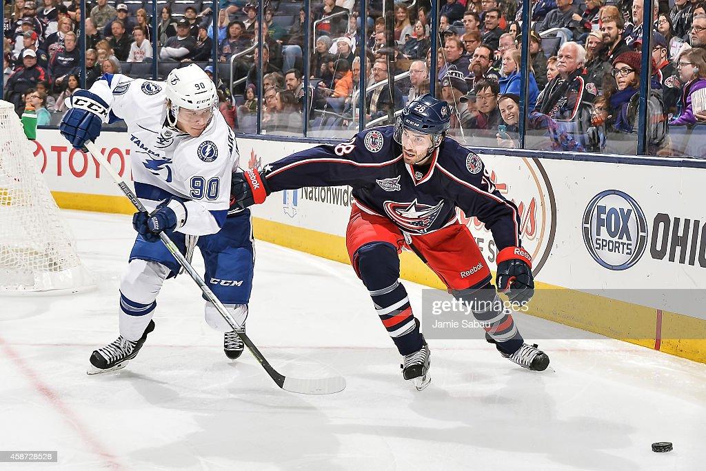 Frederic StDenis of the Columbus Blue Jackets defends against Vladislav Namestnikov of the Tampa Bay Lightning on November 8 2014 at Nationwide Arena...