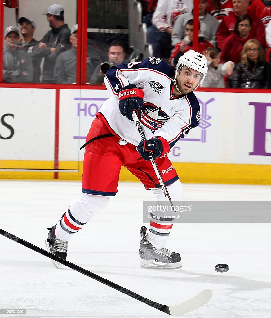 Frederic StDenis of the Columbus Blue Jackets shots the puck during their NHL game against the Carolina Hurricanes at PNC Arena on November 7 2014 in...