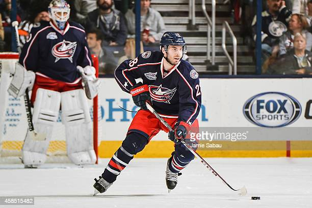 Frederic StDenis of the Columbus Blue Jackets skates with the puck against the Carolina Hurricanes on November 4 2014 at Nationwide Arena in Columbus...