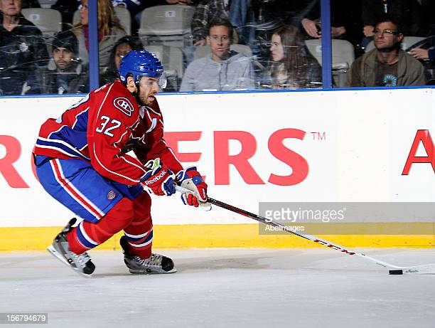 Frederic StDenis of the Hamilton Bulldogs carries the puck against the Toronto Marlies during AHL game action November 17 2012 at Ricoh Coliseum in...