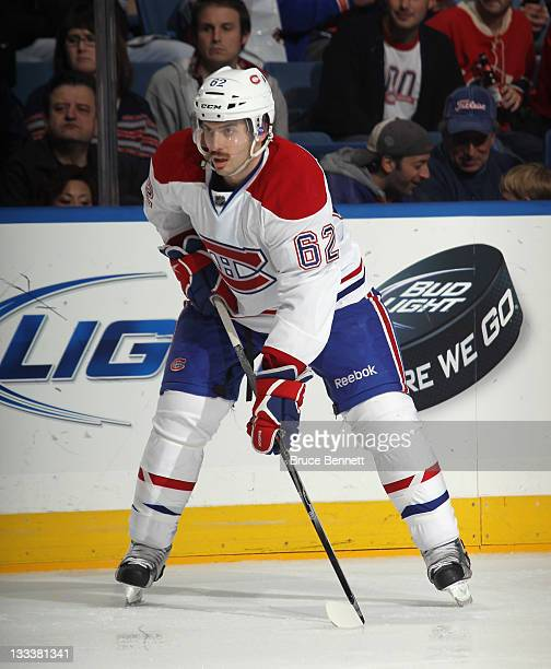 Frederic StDenis of the Montreal Canadiens skates against the New York Islanders at the Nassau Veterans Memorial Coliseum on November 17 2011 in...