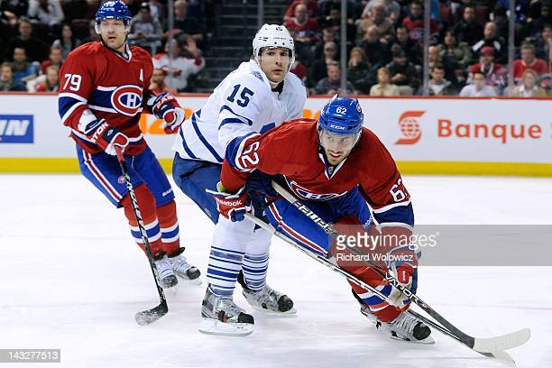 Frederic StDenis of the Montreal Canadiens skates while being checked by Matthew Lombardi of the Toronto Maple Leafs during the NHL game at the Bell...