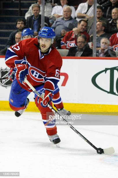Frederic StDenis of the Montreal Canadiens skates with the puck in his first career NHL game against the Carolina Hurricanes at the Bell Centre on...