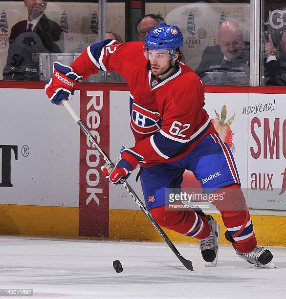 Frederic StDenis of the Montreal Canadiens skates with the puck during the NHL game against the Toronto Maple Leafs on April 7 2012 at the Bell...