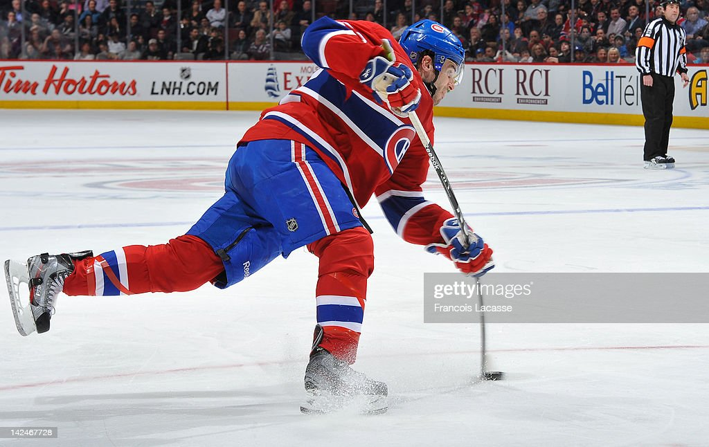 Frederic StDenis of the Montreal Canadiens takes a shot during the NHL game against the Florida Panthers on March 27 2012 at the Bell Centre in...