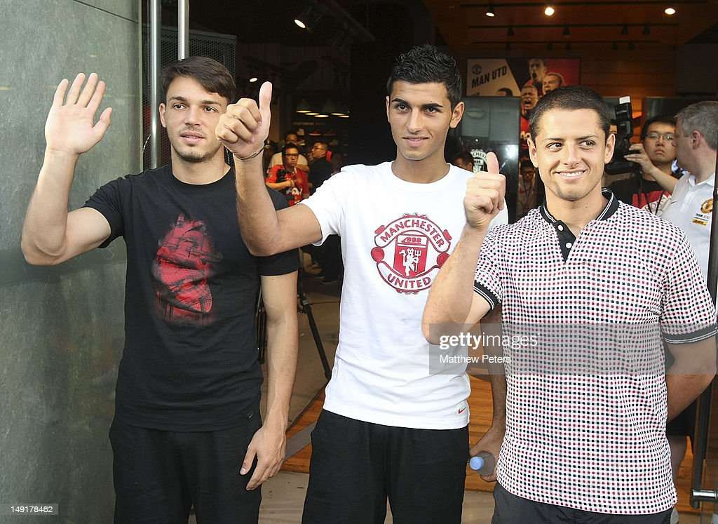 Frederic Veseli, Davide Petrucci and Javier 'Chicharito' Hernandez of Manchester United attend the launch of a new Manchester United Fitness app in association with Nike on July 24, 2012 in Shanghai, China.