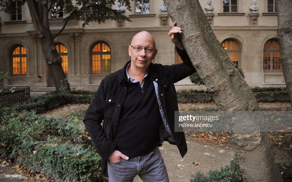 Frederic Worms, professor of philosophy and head of the international French philosophy centre at the prestigious ENS (L'Ecole normale superieure) graduate school, poses in the school's garden in Paris on November 3, 2013. Worms is an expert on late French writer and 1957 Nobel Prize laureate Albert Camus, who would have celebrated his 100th birthday this year. AFP PHOTO / PIERRE ANDRIEU