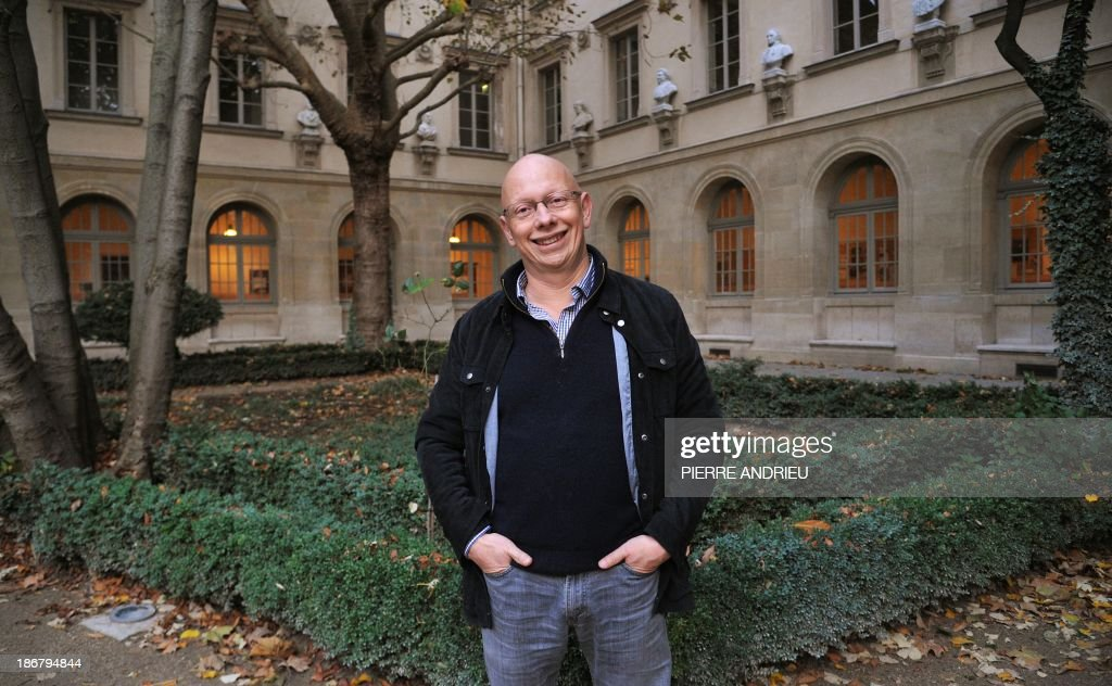 Frederic Worms, professor of philosophy and head of the international French philosophy centre at the prestigious ENS (L'Ecole normale superieure) graduate school, poses in the school's garden in Paris on November 3, 2013. Worms is an expert on late French writer and 1957 Nobel Prize laureate Albert Camus, who would have celebrated his 100th birthday this year.