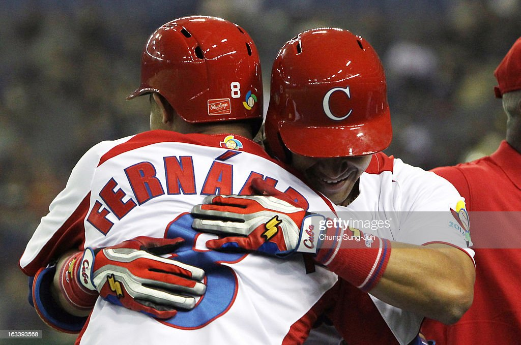 Frederich Cepeda (R) # 24 celebrates with Jose Fernandez # 8 of Cuba after two run home run bottom in the first inning during the World Baseball Classic Second Round Pool 1 game between Chinese Taipei and Cuba at Tokyo Dome on March 9, 2013 in Tokyo, Japan.
