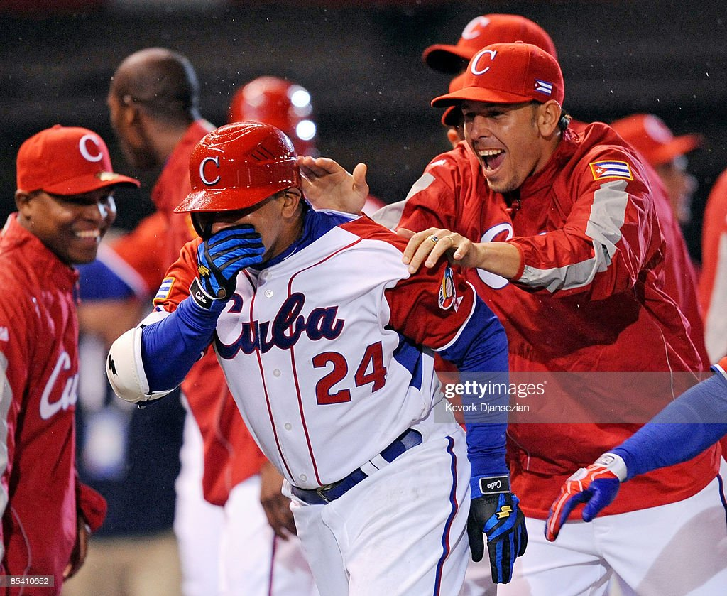 Frederich Cepeda #24 of Cuba is congratulated by pitcher Yunesky Maya after hitting a three-run home run to end the game early on the mercy rule against Mexico, 16-4, during the 2009 World Baseball Celassic Pool B match on March 12, 2009 at the Estadio Foro Sol in Mexico City, Mexico.