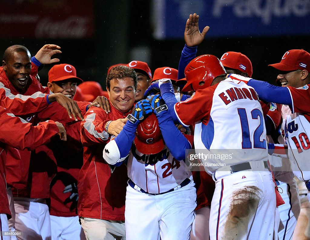 Frederich Cepeda #24 of Cuba is mobbed by his teammates and team doctor Antonio Castro, center left, son of former president of Cuba Fidel Castro, after hitting a three-run home run to end the game early on the mercy rule, 16-4, against Mexico during the 2009 World Baseball Celassic Pool B match on March 12, 2009 at the Estadio Foro Sol in Mexico City, Mexico.
