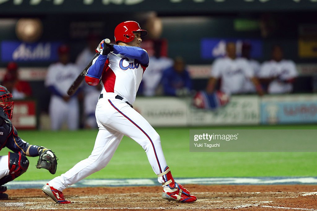Frederich Cepeda #24 of Team Cuba hits a RBI double in the bottom of the fourth inning during Pool A, Game 6 between Team Japan and Team Cuba during the first round of the 2013 World Baseball Classic at the Fukuoka Yahoo! Japan Dome on March 6, 2013 in Fukuoka, Japan.