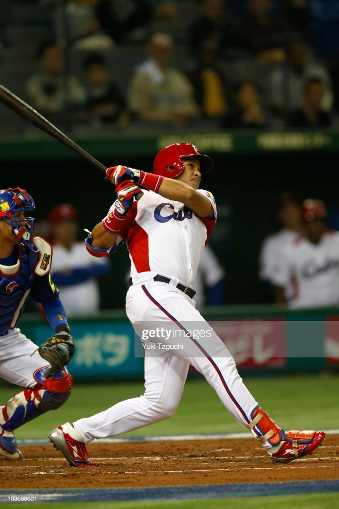 Frederich Cepeda #24 of Team Cuba hits a two run home run in the bottom of the first inning during Pool 1, Game 3 between the Chinese Taipei and Cuba in the second round of the 2013 World Baseball Classic at the Tokyo Dome on March 9, 2013 in Tokyo, Japan.